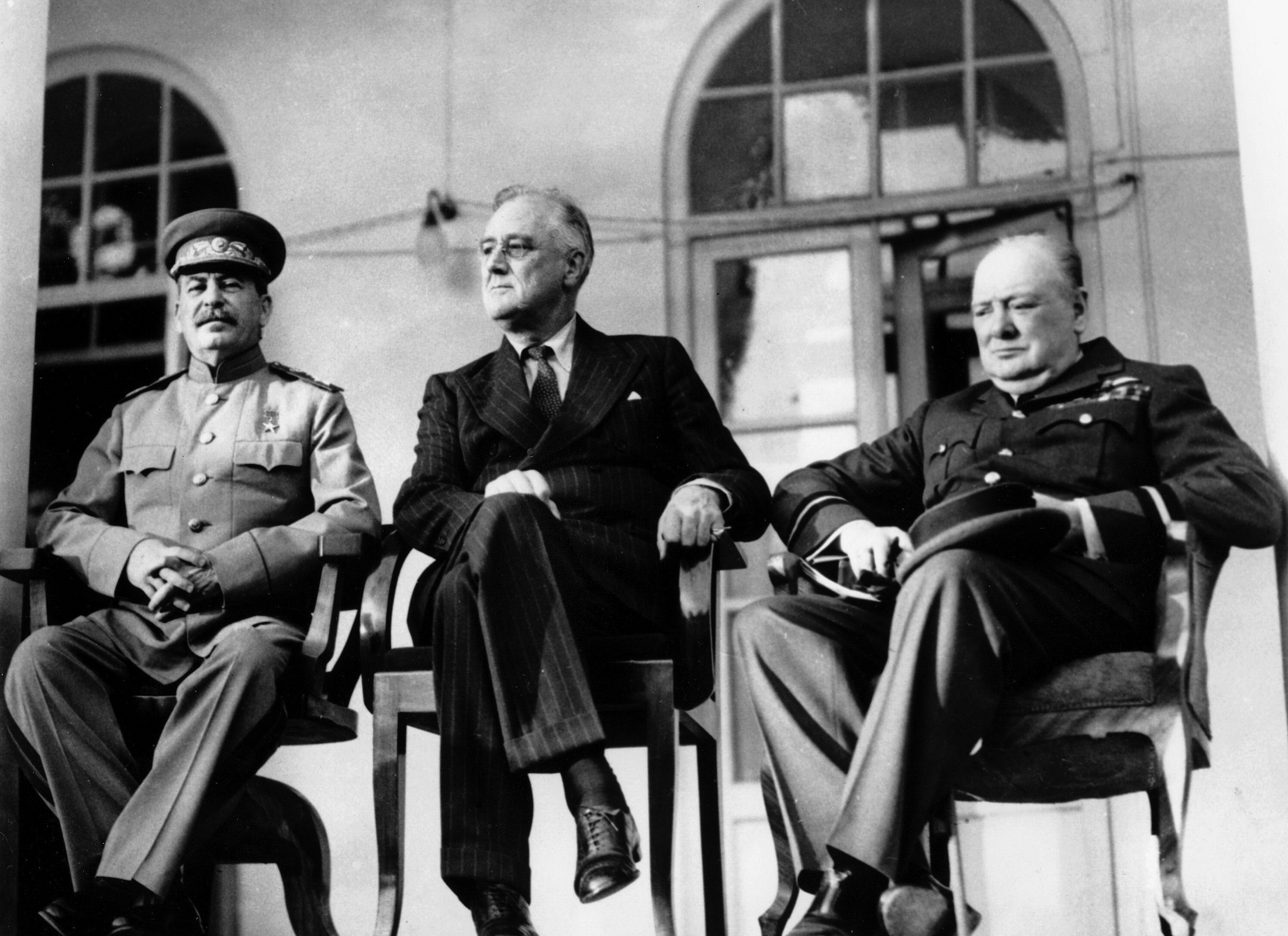 Soviet Union Premier Josef Stalin, U.S. President Franklin D. Roosevelt, center, and British Prime Minister Winston Churchill sit at the Teheran Conference in the capital of Persia, Iran, on Nov. 28, 1943. The three leaders, meeting for the first time, are to discuss Allied plans for the war against Germany and for postwar cooperation in the United Nations. (AP Photo)