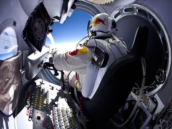 Red Bull Stratos Project...IN FLIGHT, UNSPECIFIED - MARCH 15: (EDITORS NOTE: Lens profile correction was applied to the image) (EDITORIAL USE ONLY) In this photo provided by Red Bull, Pilot Felix Baumgartner of Austria prepares to exits the capsule before his jump during the first manned test flight for Red Bull Stratos on March 15, 2012 in Roswell, New Mexico. In this test he reach the altitude 21800 meters (71500 ft) and landed safely near Roswell. Red Bull Stratos is a mission to the edge of the earths atmosphere, where upon reaching altitude of 120,000 feet by helium baloon, pilot and basejumper Felix Baumgartner will then freefall to the ground in an attempt to break the speed of sound. (Photo by Jay Nemeth/Red Bull via Getty Images)