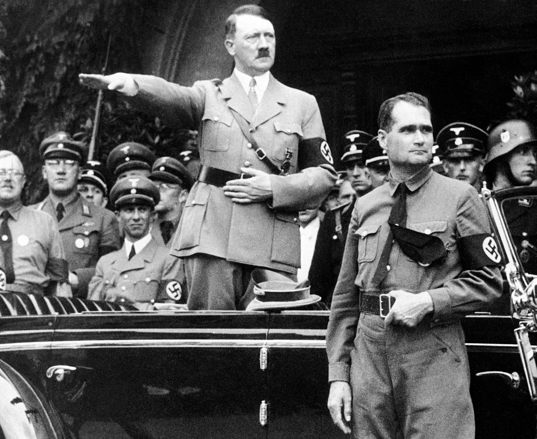 The Dec. 30 1938 file photo shows German Chancellor Adolf Hitler and his personal representative Rudolf Hess, right, during a parade in Berlin, Germany, on Dec. 30, 1938. Minister of Propaganda Dr. Joseph Goebbels can be seen on the left side next to Hitler. The skeletal remains of Adolf Hitler's deputy Hess, have been removed from their grave in a small Bavarian town that had become a pilgrimage site for neo-Nazis. The administrator of the cemetery in Wunsiedel told The Associated Press on Thursday, July 21, 2011 that the bones were exhumed early Wednesday morning. (AP Photo)