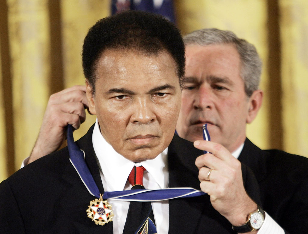 President Bush presents the Presidential Medal of Freedom, Wednesday, Nov. 9, 2005, to boxer Muhammad Ali in the East Room of the White House. (AP Photo/Evan Vucci)